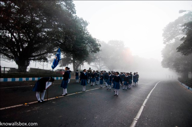School-children waiting their turn to march